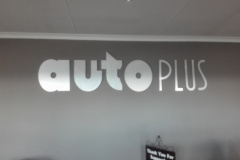 Redblock Advertising and Media - Aluminium indoor sign mounted flush against reception wall