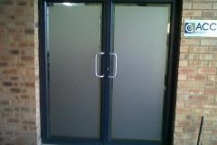 Redblock advertising media -  - Solid Sandblast applied to office doors
